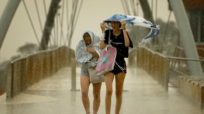 People scramble to take cover in Frankston as a storm front ripped through yesterday. Picture: Stuart McEvoy/The Australian