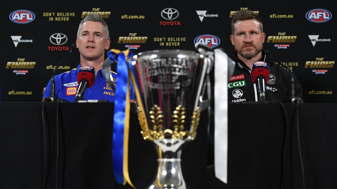 Coach of the West Cost Eagles Adam Simpson and coach of the Collingwood Magpies Nathan Buckley. Picture: Julian Smith