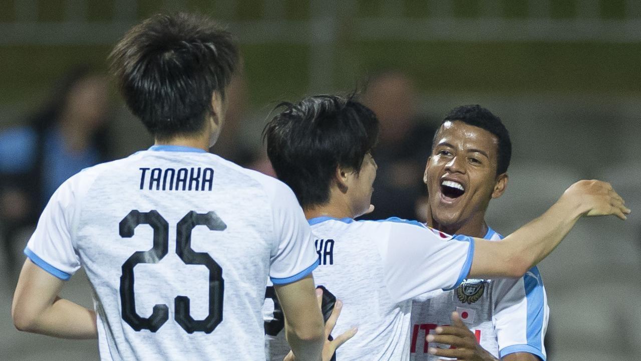 Maguinho of Kawasaki Frontale (facing ) celebrates after goal by Yasuto Wakisaka
