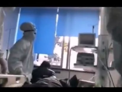 In this still from the same video, doctors work on a patient while corpses in body bags lie unattended nearby. Picture: Radio Free China