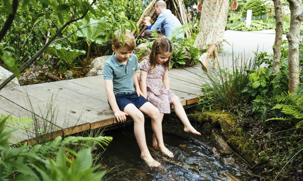 In this image made available on Sunday May 19, 2019 by Kensington Palace, Britain's Prince William, Kate, Duchess of Cambridge and their children, Prince George, front, Princess Charlotte, front, and Prince Louis play in the Adam White and Andree Davies co-designed garden ahead of the RHS Chelsea Flower Show in London. (Matt Porteous/Kensington Palace via AP)