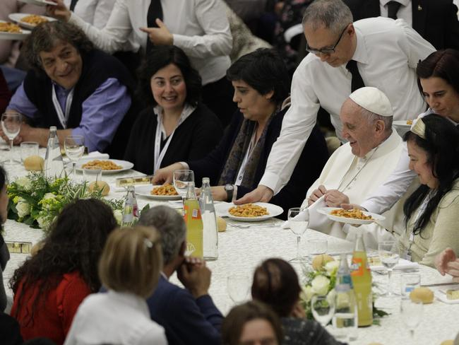 Pope Francis is served gnocchi during a lunch at the Vatican. Picture: AP/Andrew Medichini