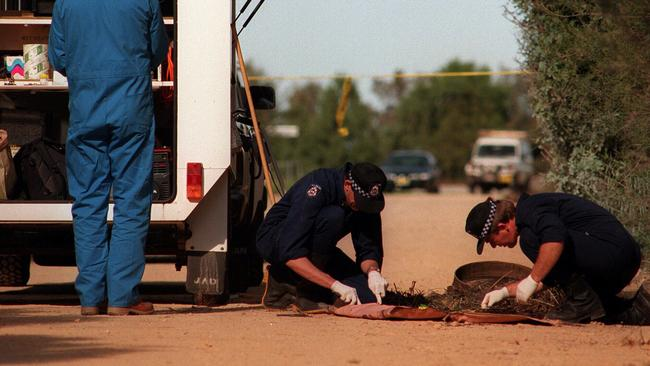 Police study forensic evidence at the Wellard crime scene where Jane Rimmer's body was found.