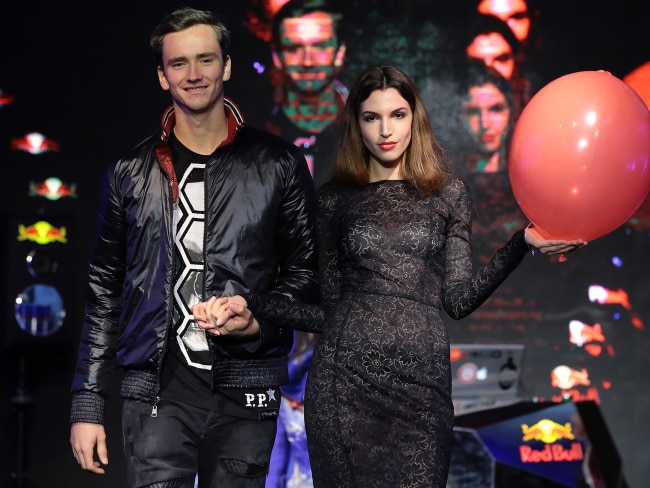 Daniil Medvedev of Russia attends the Next Gen ATP Final draw ceremony, arm in arm with a model. Photo: Emilio Andreoli/Getty