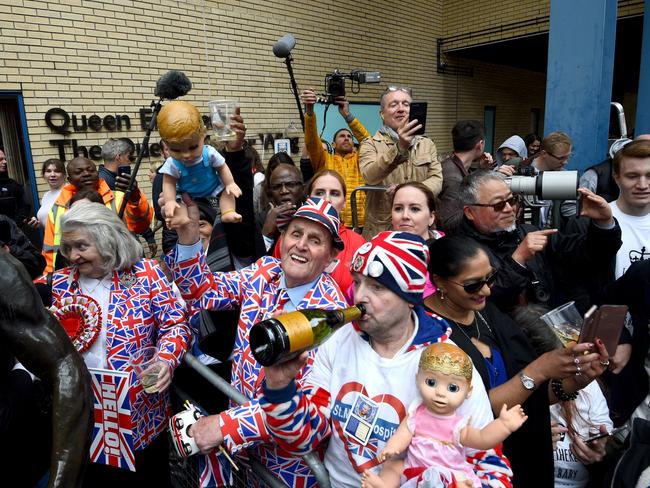 Royal fans celebrate outside the hospital in Paddington after the announcement the baby had been born around five hours after Kate arrived. Picture: Kirsty O'Connor/PA Images via Getty Images