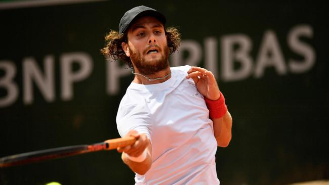 Marco Trungelliti plays a forehand return to Australia's Bernard Tomic during their men's singles first round match on day two of The Roland Garros 2018 French Open.