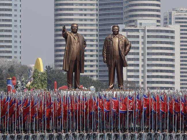In this Saturday, April 15, 2017 photo, university students carry North Korean national flags and two bronze statues of the late leaders Kim Il Sung and Kim Jong Il. Picture: AP.