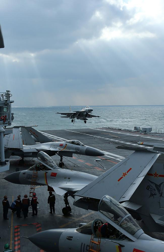 A fighter lands on the crowded deck of the Liaoning. If China's next carrier has catapults, this will vastly improve its ability to put large numbers of heavily-laden aircraft into the air, fast. Picture: Xinhua