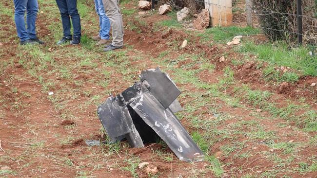 A piece from a missile that landed in the eastern Lebanese town of Rayak, near the Syrian border, after Israel's military launched a series of attacks.