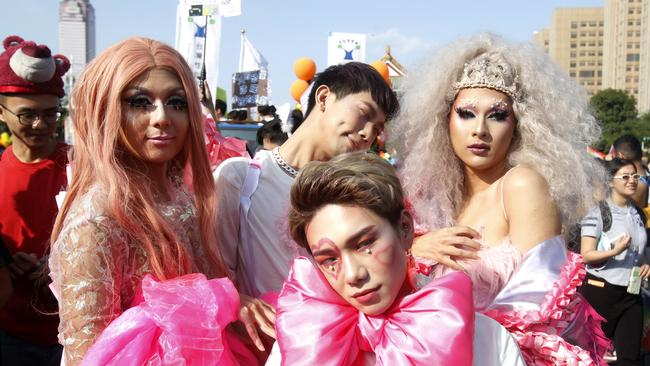 Costumed participants pose on a street during the annual gay and lesbian parade, organised by Taiwan LGBT Pride. Picture: Chiang Ying-ying / AP Photo.