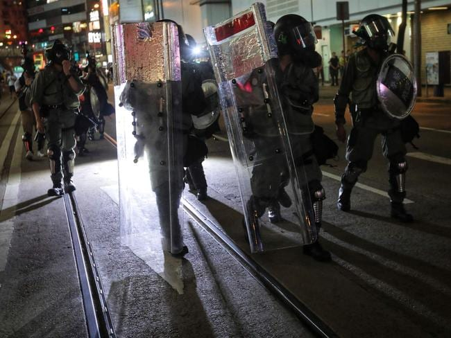 Riot police charge down a street to clear protesters in Causeway Bay in Hong Kong. Picture: AFP