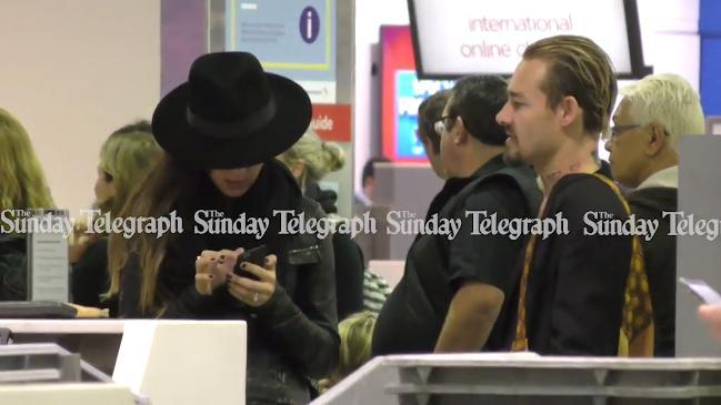 Daniel Johns and Michelle Leslie at airport check-in