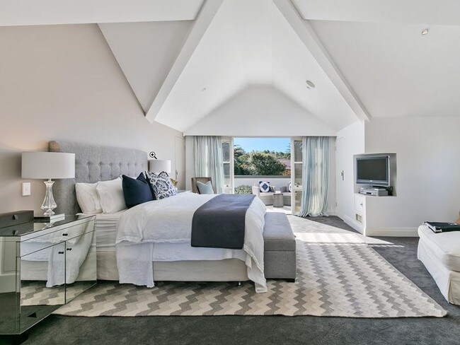 The main bedroom has a private balcony with views looking over Sydney Harbour.