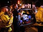Des Richardson, owner of Canine Motorcycle Recovery, hands out free food and drink to police and public following an evening vigil outside the Town Hall on May 23, 2017 in Manchester, England. Mr Richardson had decided to spend an unexpected bonus on free food for volunteers following the terrorist attack and, on mentioning this in the supermarket, was given two extra trolleys of stock to give away. Picture: Getty