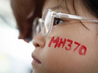 "In this photo taken March 3, 2018, a girl has her face painted during the Day of Remembrance for MH370 event in Kuala Lumpur, Malaysia. New Transport Minister Anthony Loke says the search for missing Malaysia Airline Flight 370 ends next Tuesday after a 90-day period under a ""no cure no fee"" agreement with a private U.S. firm. (AP Photo/Vincent Thian)"