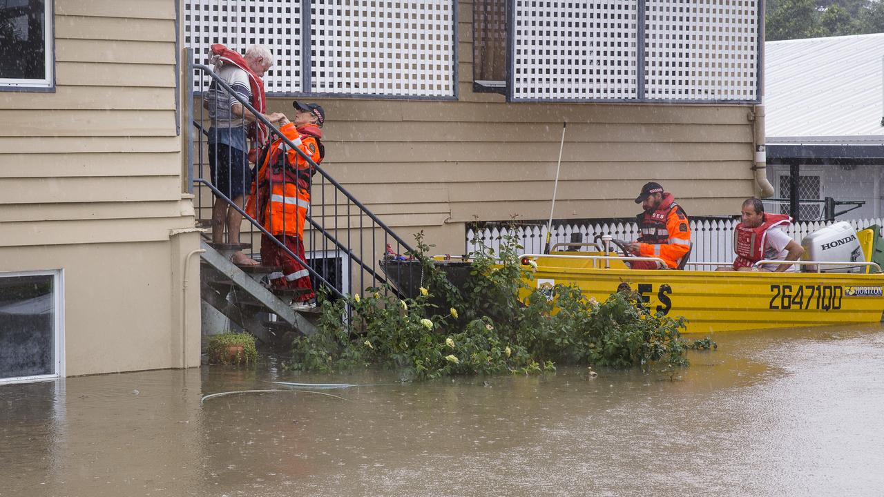 SES volunteers rescuing residents in Rosslea, Townsville on Saturday, February 2, 2019. Picture: AAP
