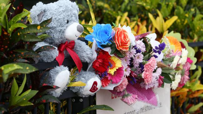 Members of the public left flowers and teddies at the school after the tragedy. Picture: Brendan Radke