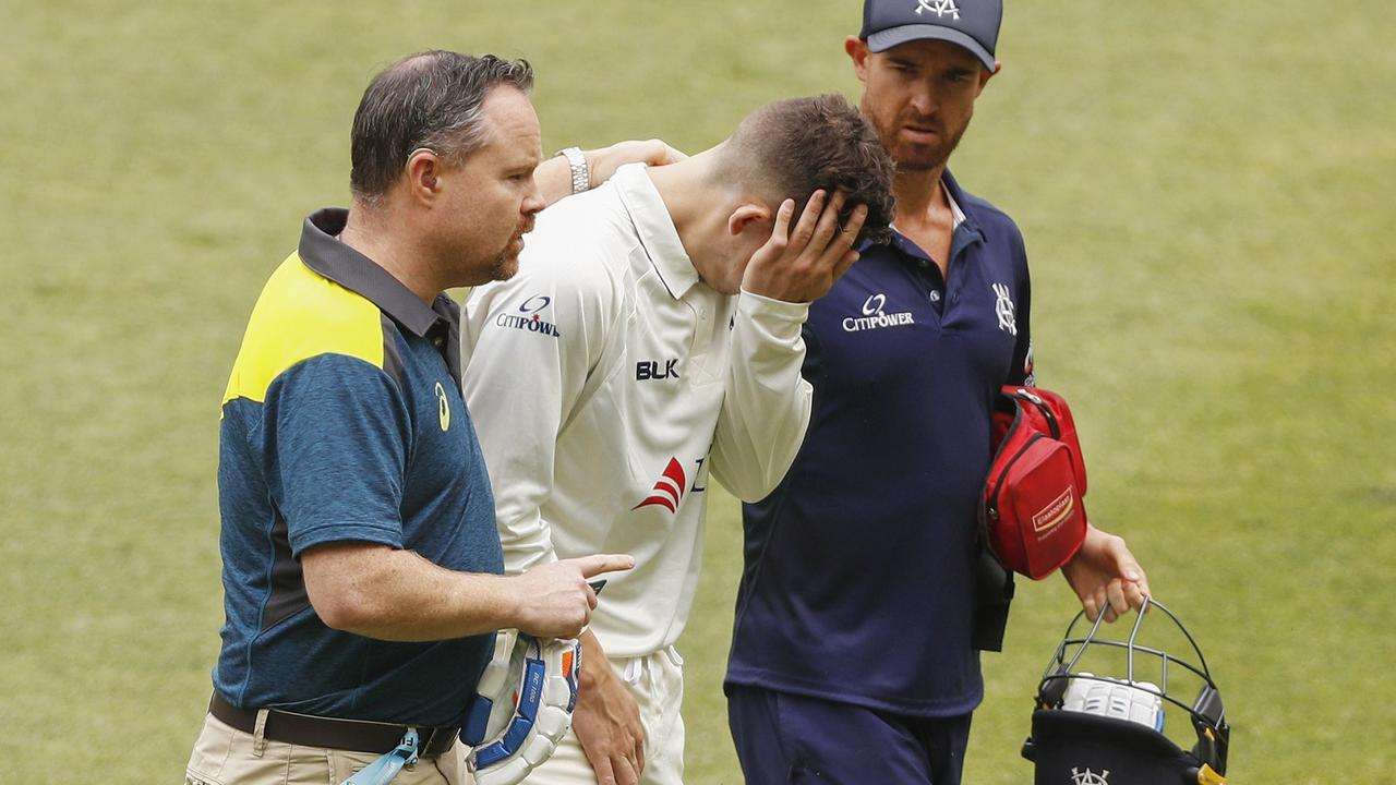 Nic Maddinson leaves the field with a wrist injury.
