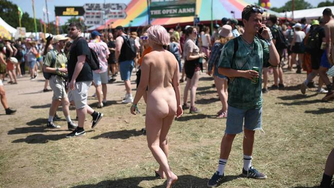 With temperatures set to hit 30 degrees in Glastonbury, some festival-goers have resorted to fully stripping. Picture: Photo by Oli Scarff / AFP