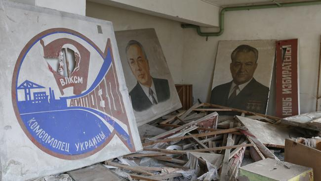 Portraits of Soviet leaders are covered by radioactive dust in a club. Picture: AP Photo/Efrem Lukatsky