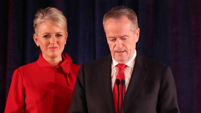 Bill Shorten delivers his concession speech to Labor Party faithful, supported by wife Chloe, in Melbourne last night. Picture: Getty Images