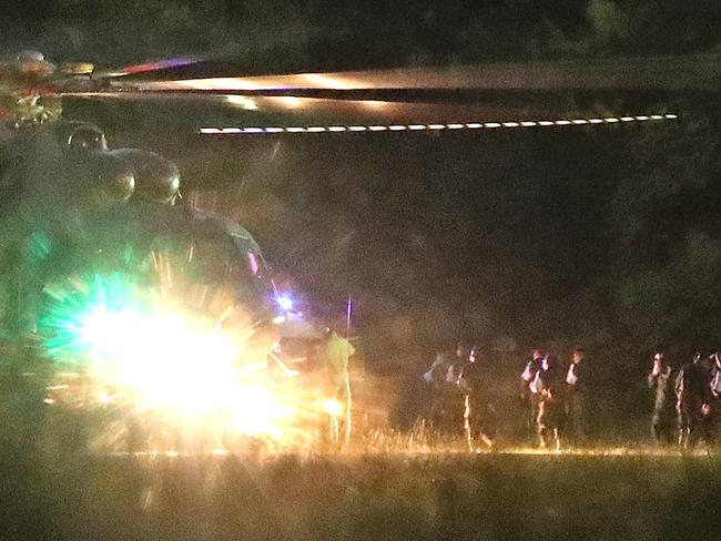Medics evacuate the first two children via helicopter after they were rescued from Tham Luang cave before heading to hospital. Picture: EPA