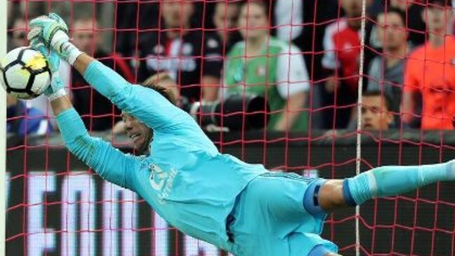 Brad Jones at full stretch for Feyenoord.