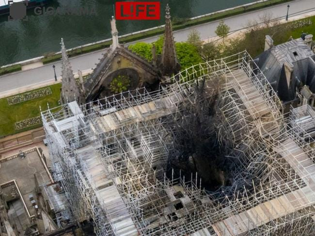 Fire damage seen in the centre of the cathedral's scaffolding. Picture: Gigarama