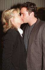 In love.. the actors kiss at a film industry cocktail party at The Windsor Hotel, Melbourne in 1995. Picture: News Corp Australia