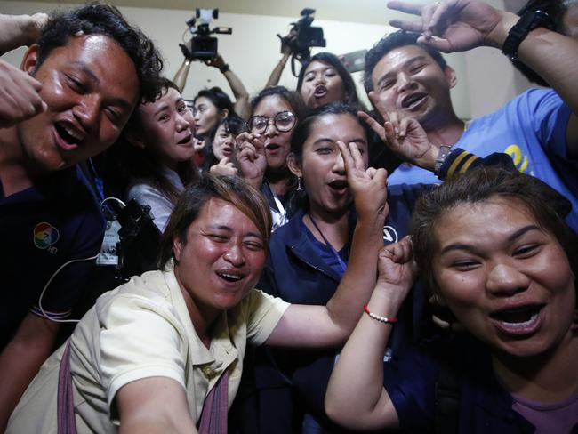 Thai media celebrate after the boys and their coach were freed. Picture: AP