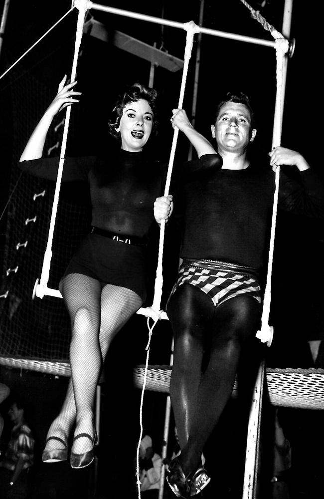 Husband and wife actors Ida Lupino and Howard Duff on the trapeze in their TV show Mr Adams And Eve in 1957.