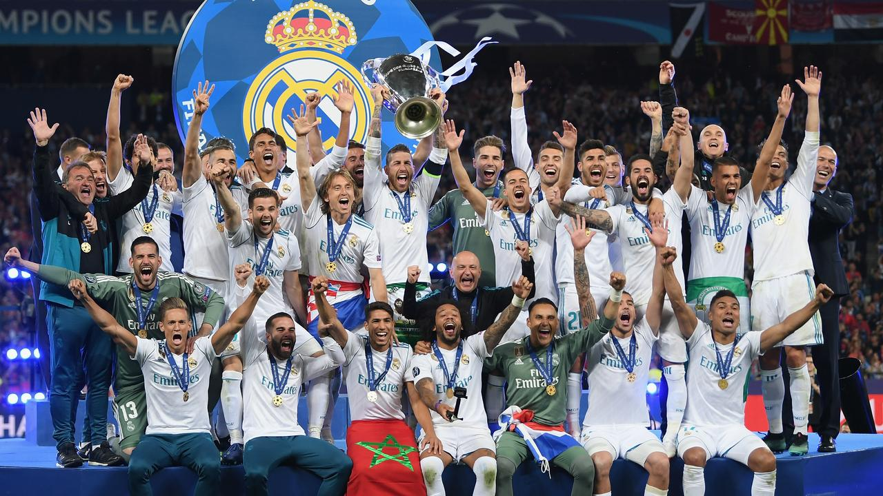 Sergio Ramos lifts the Champions League trophy for Real Madrid.