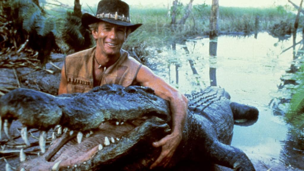 Paul Hogan in Crocodile Dundee, which opened in the US on this day in 1986.