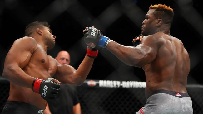 Francis Ngannou of France (R) battles Alistair Overeem of the Netherlands.