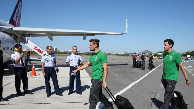 Socceroos James Holland and Ryan McGowan board a plane in Brazil during the 2014 World Cup.