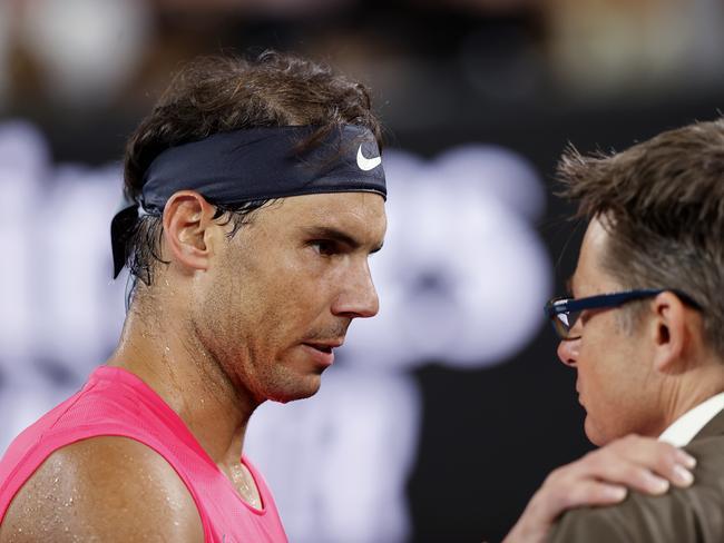 Rafael Nadal talks to a Slam official