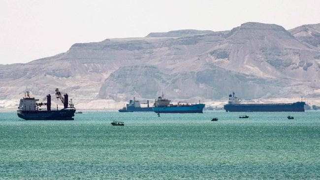 Tanker and freight ships near the entrance of the Suez Canal, by Egypt's Red Sea port city of Suez. Picture: Ahmed Hasan/AFP