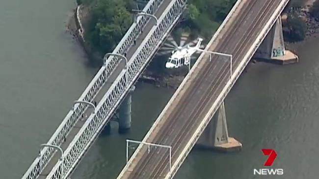 The man was jumping off the rail bridge into the Georges River. Picture: Seven News
