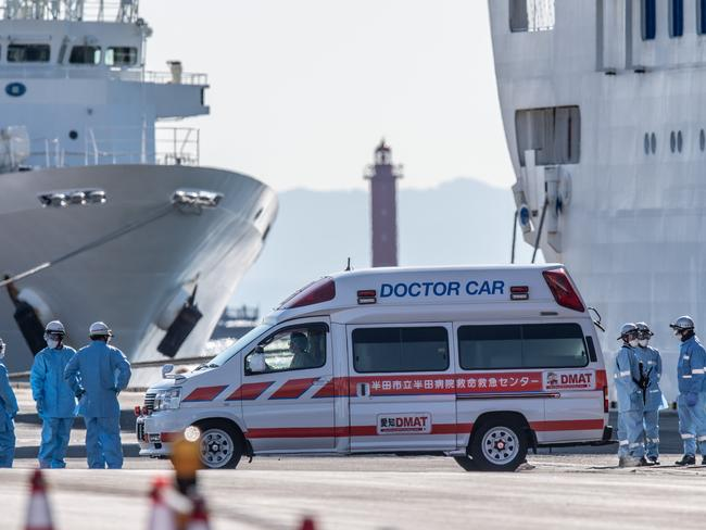 An ambulance drives away from the Diamond Princess cruise ship as it sits docked off the coast of Japan. Picture: Carl Court/Getty Images