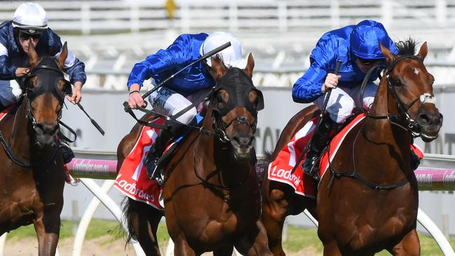 Benbatl (right) clings on to victory ahead of Blair House. Picture: Getty Images