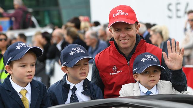 SA jockey Kerrin McEvoy with his children during the Melbourne Cup Parade. Picture: AAP / Julian Smith