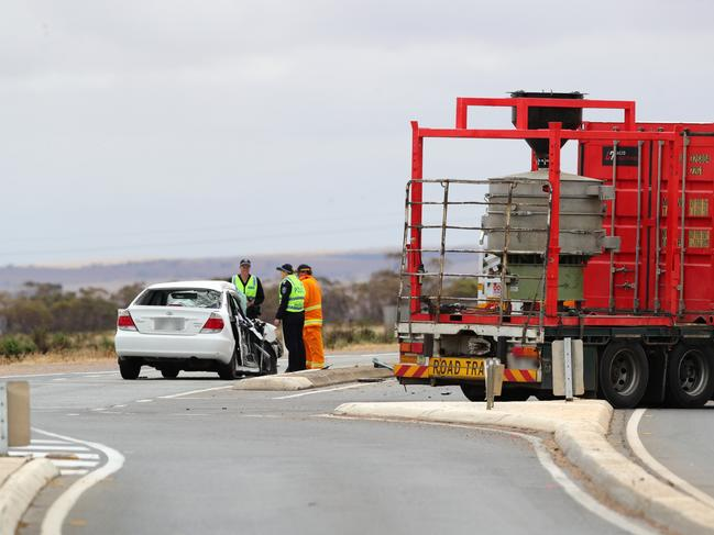 Eemrgency services at the scene of the collision between a car and a roadtrain on the Copper Coast / Augusta highways intersection at Port Wakefield. Picture: Tait Schmaal