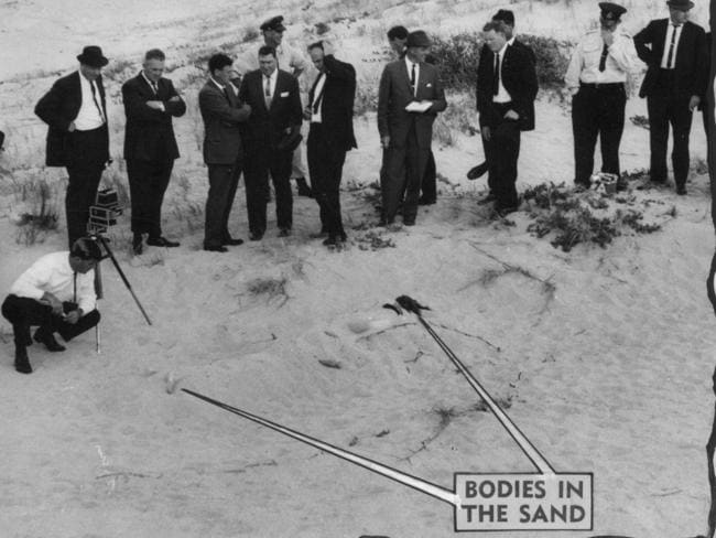 Detectives on Wanda Beach with arrows pointing to where the mutilated bodies of Marianne Schmidt and Christine Sharrock were found in the sand. Picture: News Corp..
