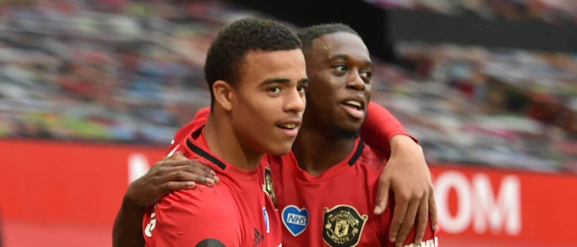 Manchester United's English striker Mason Greenwood (L) celebrates with Manchester United's English defender Aaron Wan-Bissaka after scoring a goal during the English Premier League football match between Manchester United and Bournemouth at Old Trafford in Manchester, north west England, on July 4, 2020. (Photo by PETER POWELL / POOL / AFP) / RESTRICTED TO EDITORIAL USE. No use with unauthorized audio, video, data, fixture lists, club/league logos or 'live' services. Online in-match use limited to 120 images. An additional 40 images may be used in extra time. No video emulation. Social media in-match use limited to 120 images. An additional 40 images may be used in extra time. No use in betting publications, games or single club/league/player publications. /