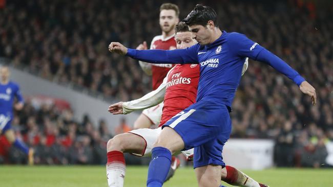 Chelsea's Alvaro Morata vies for the ball with Arsenal's Shkodran Mustafi.