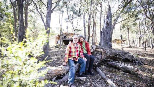 Tom and Carol Ann Fisher on the property where they've lived for decades — and are now selling. Picture: Nicole Cleary