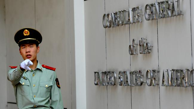 A Chinese police officer at the entrance to the US consulate in Chengdu, southwest China'. Picture: GOH Chai Hin / AFP.