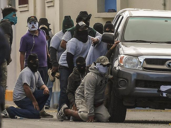 Paramilitaries surround a church on July 9. Picture: Marvin Recinos