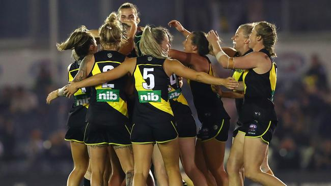 Richmond players celebrate their first goal in AFLW during the final quarter of Friday night's season opener against Carlton. Picture: Getty Images