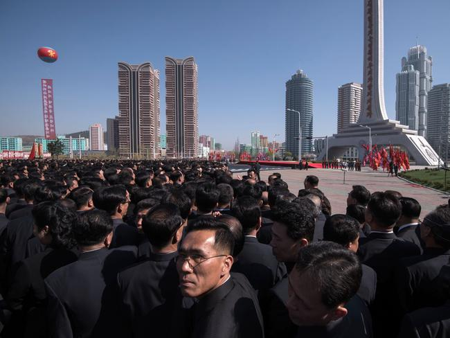 Attendees wait for the arrival of North Korea's leader Kim Jong-un at the opening ceremony for the Ryomyong Street housing development. Picture: Ed Jones/AFP